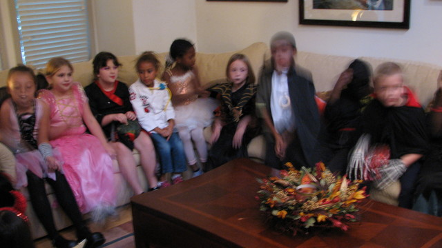 playing a game at the halloween party (katy, zoe's friend is in the black & red geisha dress)